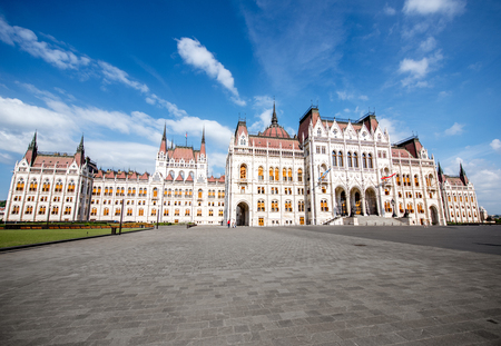 View on the main fasade of the famous Parliament building during the morning light in Budapest, Hungary