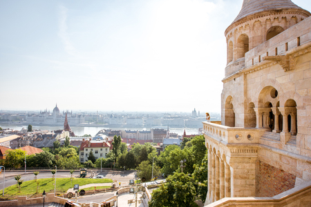 View on the wall of Fisermans bastion with woman standing on the terrace enjoying the view on Budapest city in Hungary