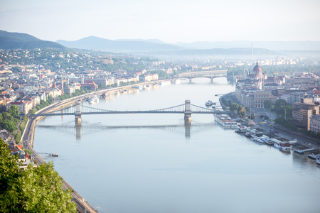 Aerial view on Budapest city with Chain bridge on Danube river and Parliament building during the morning light in Hungary Imagens
