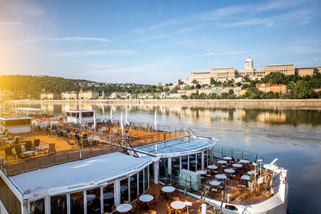 Cityscape view on Buda riverside with restaurant ship on Danube river in Budapest city, Hungary