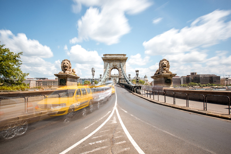 Road view on the Chain bridge with motion blurred cars during the daylight in Budapest, Hungary. Long exposure image technic Stockfoto - 105421697