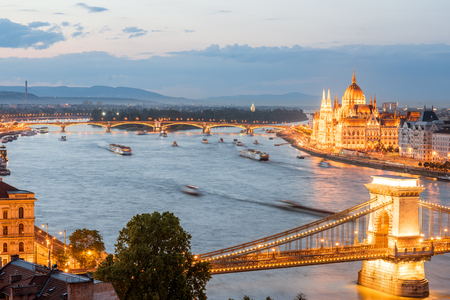 Aerial cityscape view with illuminated Chain bridge and famous Parliament building during the twilight in Budapest, Hungary