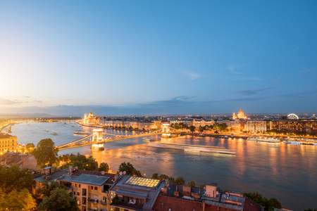 Aerial panoramic cityscape view on illuminated city during the twilight in Budapest, Hungary Stock Photo