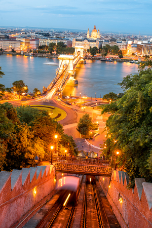 Aerial cityscape view with illuminated chain bridge and funicular railway during the twilight in Budapest, Hungary