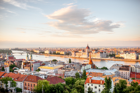 Beautiful view on the Budapest city with river and famous Parliament building during the sunset in Hungary Stock Photo