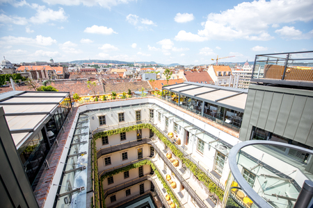 HUNGARY, BUDAPEST - MAY 19, 2018: Top cityscape view with beautiful atrium of the Aria hotel by Library hotel collection in Budapest