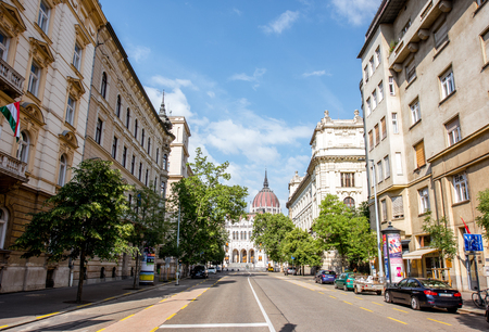 HUNGARY, BUDAPEST - MAY 20, 2018: Street view with famous Parliament building, the seat of the National Assembly of Hungary during the sunny weather in Budapest Editöryel