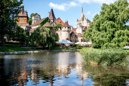 HUNGARY, BUDAPEST - MAY 20, 2018: View on the Vajdahunyad Castle with beautiful lake in the City Park. This castle was built between 1896 and 1908 and designed by Ignac Alpar Editorial