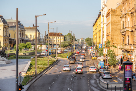 HUNGARY, BUDAPEST - MAY 18, 2018: Street view with cars and beautiful buildings near the eastern railway staion during the sunset in Budapest Archivio Fotografico - 105120647
