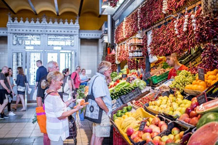 HUNGARY, BUDAPEST - MAY 19, 2018: People buying fresh vegetables in the famous Great Market hall largest and oldest indoor market in Budapest, Hungary