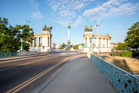 Morning view on the empty road and Heroes square during the sunny weather in Budapest, Hungary