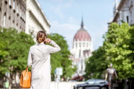 Woman enjoying street view with Parliament building in Budapest city, Hungary Stok Fotoğraf