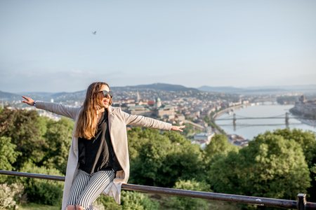 Young woman enjoying beautiful aerial cityscape view on Budapest during the morning light, Hungary Stock Photo