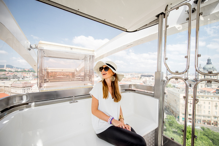Young woman tourist enjoying aerial cityscape view from the ferries wheel in Budapest city, Hungary Standard-Bild