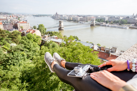 Landscape view on Budapest city with legs and photo camera on the foreground