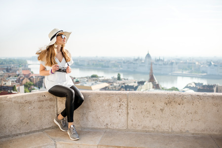 Young woman tourist enjoying great citysacape view traveling in Budapest city, Hungary