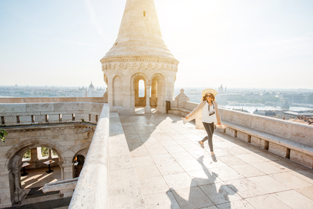 Young woman tourist on the terrace with great cityscape view traveling in Budapest, Hungary Фото со стока
