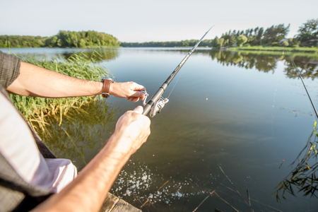 Fishing rod on the beautiful lake background during the morning light