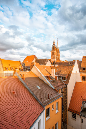 Top cityscape view on the old town with cathedral in Nurnberg during the sunset, Germany