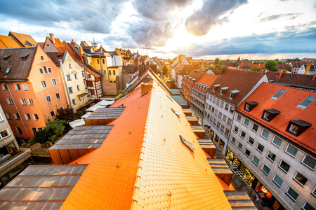 Top cityscape view on the old town with colorful buildings in Nurnberg during the sunset, Germany
