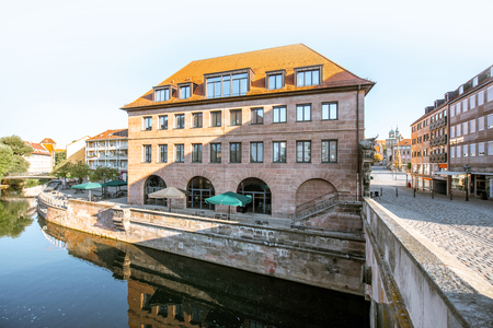 Morning view on the riverside with old buildings in the old town of Nurnberg city, Germany