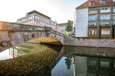 Morning view on the riverside with bridge and buildings in the old town of Nurnberg city, Germany