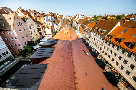 Top cityscape view on the old town with beautiful old buildings in Nurnberg during the sunrise, Germany