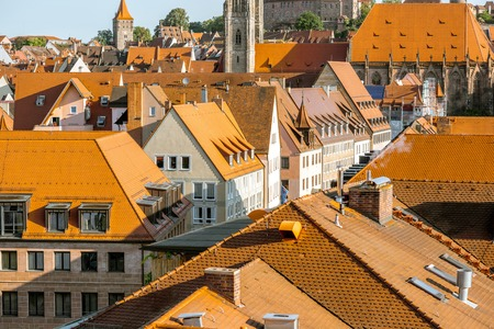 Top cityscape view on the old town with beautiful buildings in Nurnberg during the sunrise, Germany