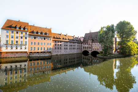 Morning view on the riverside with beautiful old buildings in Nurnberg city, Germany 写真素材
