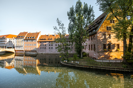 Morning view on the riverside with beautiful old buildings and bridge in Nurnberg city, Germany