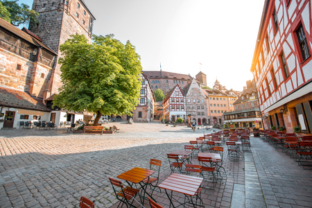 Morning view on the beautiful city square with half-timbered houses and old building on the background in Nurnberg, Germany