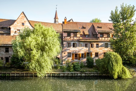 Morning view on the riverside with beautiful old buildings in Nurnberg city, Germany Banco de Imagens