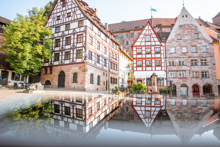 Morning view on the beautiful half-timbered houses with reflection in the old town of Nurnberg, Germany Фото со стока