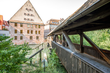 Morning view on the ancient wooden bridge on Pegnitz river in Nurnberg, Germany