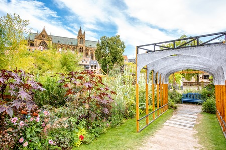 Beautiful garden on Comedy square with cathedral on the background in Metz city, France