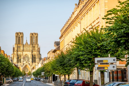 Street view with famous cathedral in Reims city in Champagne-Ardenne region, France