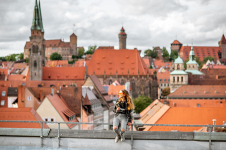 Young woman tourist enjoying beautiful aerial view on the old town of Nurnberg city, Germany Stok Fotoğraf