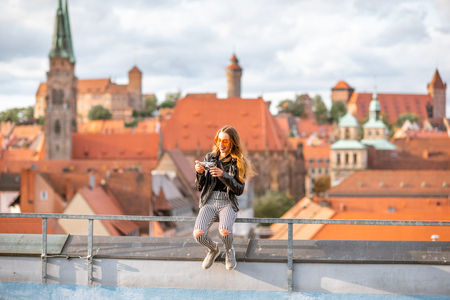 Young woman tourist enjoying beautiful aerial view on the old town of Nurnberg city, Germany Фото со стока