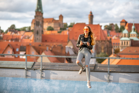 Young woman tourist enjoying beautiful aerial view on the old town of Nurnberg city, Germany 스톡 콘텐츠