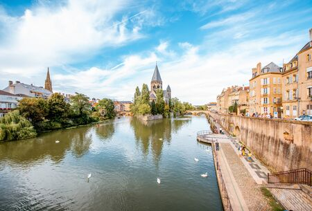 METZ, FRANCE - August 26, 2017: Landscape view on the riverside with Neuf basilica in Metz city of Lorraine region in France