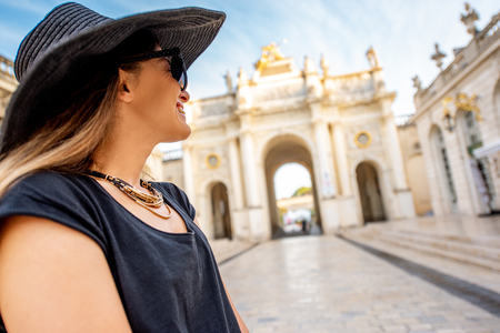 Young woman tourist enjoying beautiful triumphal arch traveling in Nancy city in France Stock Photo