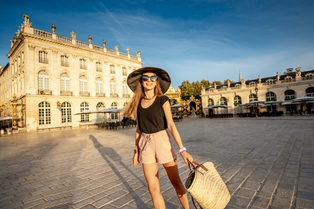 Young woman tourist having fun on the central square traveling in Nancy city in France