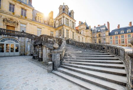 FONTAINBLEAU, FRANCE - August 28, 2017: View on the famous staircase in Fontainebleau palace during the morning light in France 報道画像