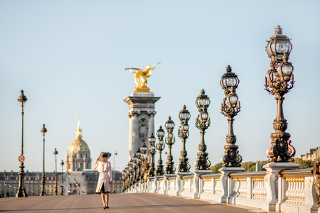 View on the famous Alexandre bridge with beautiful woman walking during the morning view in Paris