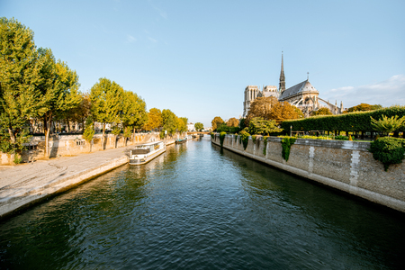 Landscape view on the famous Notre-Dame cathedral on Seine river during the morning light in Paris, France Banco de Imagens