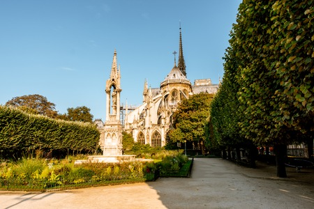 View on the baackyard of the famous Notre-Dame cathedral during the morning light in Paris, France Фото со стока