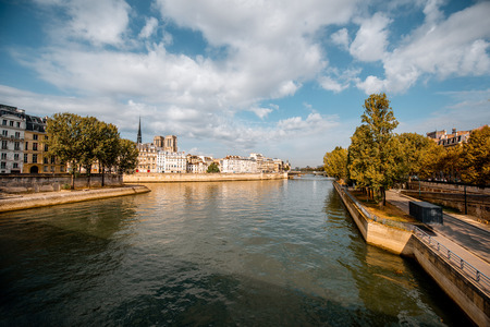Landscape view on the river with Notres-Dame cathedral in Paris, France