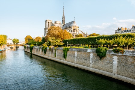 Landscape view on the famous Notre-Dame cathedral on Seine river during the morning light in Paris, France Фото со стока
