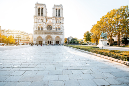 View on the famous Notre-Dame cathedral and empty square during the morning light in Paris, France