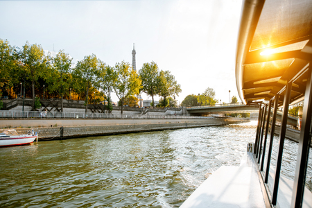 View on the riverside from the boat sailing on Seine river during the sunset in Paris Фото со стока